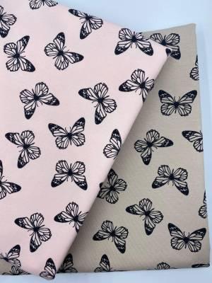Черные бабочки на светло-розовом